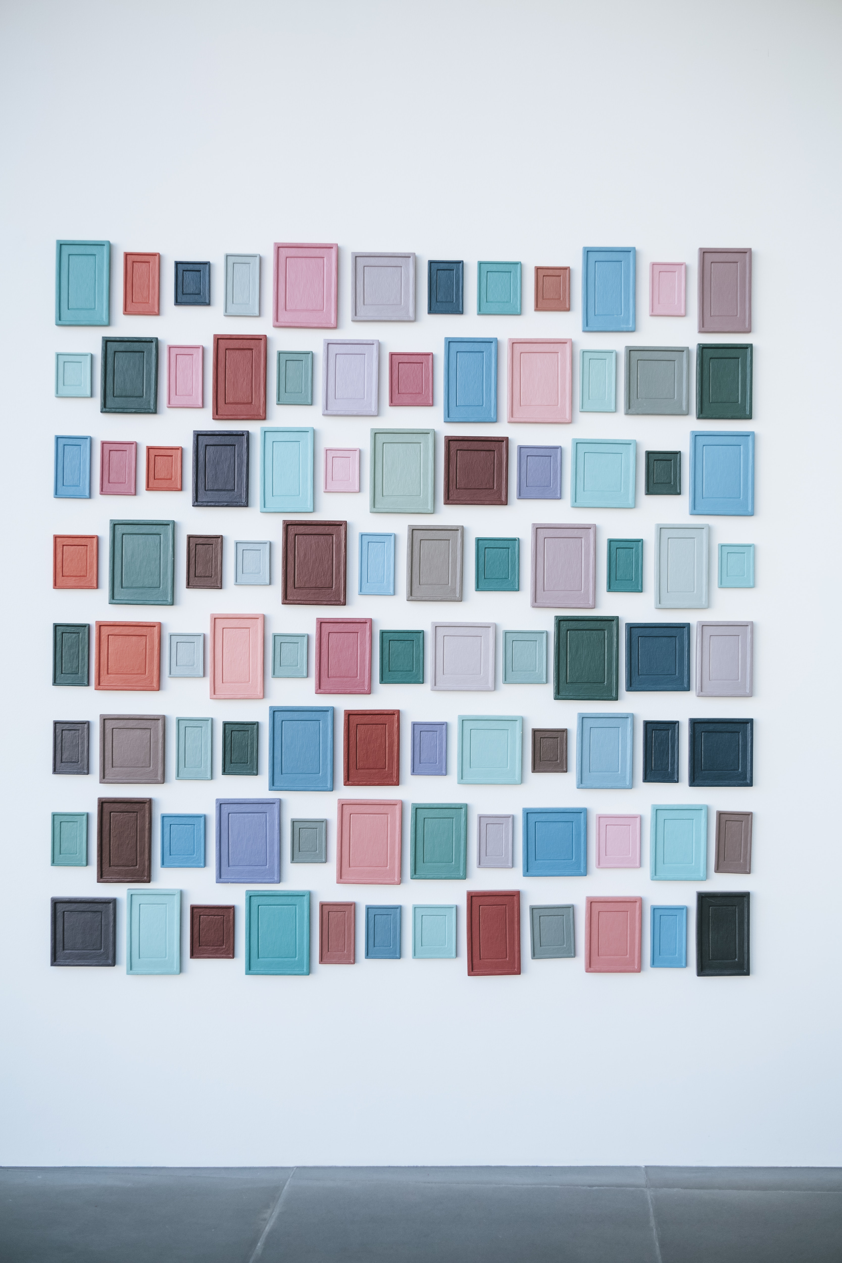 different color frames on a wall